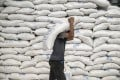 A worker carries a sack of rice inside a National Food Authority warehouse in Valenzuela, Metro Manila, the Philippines, on Thursday, March 26, 2020. File photo: Veejay Villafranca/Bloomberg
