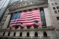 US national flags flutter outside the New York Stock Exchange. The US has the world's largest stock market with a capitalisation of US$29 trillion. Photo: Xinhua