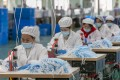 China, the world's largest producer of face masks and protective gowns, has come under fire over the export of defective medical gear recently. Photo: Xinhua