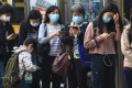 Commuters in masks queue for public transport in Hong Kong. Photo: May Tse