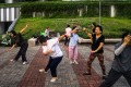 Singaporean residents practise tai chi at a Housing and Development Board (HDB) public housing estate in 2015. Photo: Bloomberg