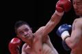 Xiong Chaozhong lands a punch during a WBC Asian Championship bout. Photos: Handout