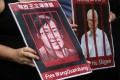 """A picture of Chinese human rights lawyer Wang Quanzhang is held up during a silent protest outside the Hong Kong Court of Final Appeal, on July 9, 2018, the third anniversary of China's """"709"""" crackdown on human rights lawyers. Photo: K.Y. Cheng"""