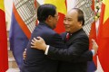Cambodian Prime Minister Hun Sen (left) greets Vietnam's Nguyen Xuan Phuc ahead of talks in Hanoi. As a major power rivalry re-emerges, the neighbouring countries may find themselves in opposing camps. Photo: AP