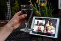 A woman lifts her glass to share a toast with friends online via the Houseparty app during a virtual happy hour on April 8 in Arlington, Virginia. Photo: AFP