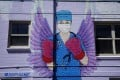 A mural depicting a medical worker in downtown Denver, United States. Photo: AFP