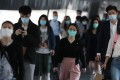Office workers in face masks going to work in Central amid the coronavirus outbreak. Photo: Nora Tam