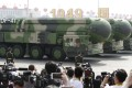 Military vehicles carrying DF-41 intercontinental ballistic missiles travel past Tiananmen Square in Beijing in October 2019. Photo: Reuters