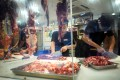 Workers cut beef in Shenzhen, Guangdong. Photo: Reuters