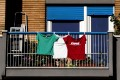 Three T-shirts in the colours of the Italian flag are displayed on a balcony during the emergency lockdown in Rome on Thursday. Photo: EPA-EFE