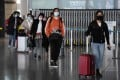Passengers arrive on a domestic flight at the Beijing Capital Airport on March 27, 2020. Photo: Agence France-Presse