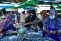 Women buy seafood at a market in Thailand's southern province of Narathiwat. Photo: AFP