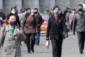 Pedestrians seen in face masks in Pyongyang on April 1, 2020. Photo: AP
