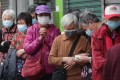 Elderly Hongkongers queue for free surgical masks in Sham Shui Po on February 14. The Jockey Club's relief measures include sourcing and funding the purchase of 14 million face masks. Photo: Edmond So