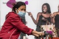 A woman passes by a poster in a part of Guangzhou where a lot of the African people live and work, and have reportedly faced racial discrimination stemming from the coronavirus outbreak. Photo: EPA-EFE
