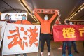 Supporters of Wuhan Zall football club welcome the team when they arrive in the city. Photo: Xinhua