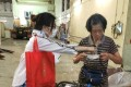 A cleaner receives protective face masks, in Central on March 25. Photo: Handout
