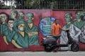 A coronavirus mural in Depok, on the outskirts of Jakarta, Indonesia. Photo: AP