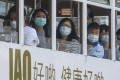 Passengers on a tram in Hong Kong wear masks to guard against the coronavirus. Photo: Dickson Lee