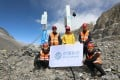 A team from China Mobile shows off the initial 5G base stations, supplied by Huawei Technologies, that the telecoms carrier deployed on Mount Everest this April. Photo: Weibo