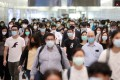 Hongkongers live in hope the coronavirus is in retreat but social-distancing measures will remain in force. Photo: Winson Wong