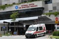 An ambulance leaves Singapore's National Centre for Infectious Diseases, where coronavirus patients are being cared for. Photo: Roslan Rahman/AFP