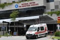 An ambulance leaves the National Centre for Infectious Diseases, where Covid-19 patients are being treated. Singapore has over 11,000 acute care hospital beds in public and private hospitals. Photo: AFP