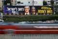 Traffic moves past a Blue and White party election campaign poster depicting party leader Benny Gantz, and Israeli Prime Minister Benjamin Netanyahu, in Tel Aviv, Israel in February. Photo: Reuters