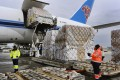 Ground crew at the Los Angeles International Airport unload pallets of supplies of medical personal protective equipment from a China Southern Cargo plane on April 10. Photo: AP