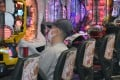 A man wearing a face mask at a pachinko parlour in Osaka. Photo: Kyodo