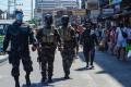Policemen patrol on patrol during lockdown in Manila. Photo: AFP