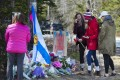 People pay their respects at a memorial in Portapique, Nova Scotia, following last Saturday's shooting rampage. Photo: AP
