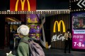 American chains Starbucks, McDonald's and Subway were named on the People's Bank of China's list of firms that will test the digital currency in small transactions with 19 local businesses. Photo: Bloomberg