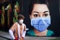 A man walks past a mural depicting a nurse in London, Britain, on April 21, 2020. Photo: Reuters