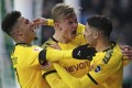 Borussia Dortmund players celebrate scoring a goal against Werder Bremen in the German Bundesliga. The league is set to resume on May 9. Photo: AP