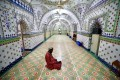 A Muslim devotee recites the Koran at the Star Mosque in Dhaka, Bangladesh, during Ramadan. Most mosques across Asia are empty due to the coronavirus pandemic. Photo: Reuters