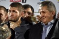 UFC lightweight champion Khabib Nurmagomedov (left) holds his belt next to his father Abdulmanap at the Anzhi Arena stadium in Makhachkala in 2018. Photo: AFP