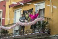 Aa woman sings on her decorated balcony during the annual traditional April Fair in Seville, Spain. Photo: AP