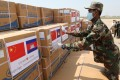 A Cambodian soldier unloads medical supplies donated by China on Saturday at Phnom Penh International Airport. Photo: EPA-EFE