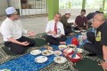 Malaysia's Deputy Health Minister Noor Azmi Ghazali, centre, and others at the meal on April 18. Photo: Facebook