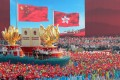 """A float featuring the """"one country, two systems"""" policy in Macau and Hong Kong passes Tiananmen Square in Beijing, during a parade marking the 70th anniversary of the founding of the People's Republic of China on October 1, 2019. Photo: CNS via Reuters"""