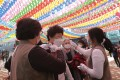 Devotees receive temperature check as they arrive to celebrate Buddha's birthday at the Chogyesa temple in Seoul. Photo: AP