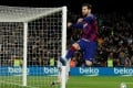 Barcelona's Lionel Messi celebrates scoring against Real Sociedad in March. Photo: Reuters