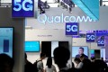 Signs of Qualcomm and 5G are pictured at Mobile World Congress (MWC) in Shanghai, China June 28, 2019. Photo: Reuters