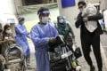Hong Kong residents returning from Pakistan at airport. Photo: K.Y. Cheng