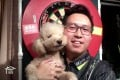 Kevin Leung Kai-fan with his dog Bauble after his match against Chris Dobey. Photo: PDC