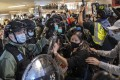Hong Kong riot police wearing protective masks try to disperse demonstrators at Cityplaza shopping mall in Taikoo on April 26. Photo: Bloomberg