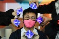 Hong Kong inventor Stark Chan Yik-hei's reusable mask with photo catalyst coating, an alternative method of surface disinfection, is among innovations sparked by the Covid-19 pandemic. Photo: May Tse
