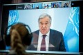United Nations Secretary-General Antonio Guterres is seen on a video screen during a virtual climate summit in Berlin on Tuesday. Photo: Reuters