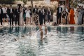 A couple who met in the lift of the Mandarin Oriental Hong Kong hotel married in a lavish wedding in Ibiza, Spain – complete with synchronised swimmers, celebrity DJs and waiters who broke out into song.